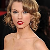 Taylor Swift's signature hair and makeup look is an instant classic: blond hair, black eyeliner, and red lipstick.