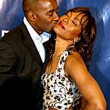 Courtney gave Angela a sweet kiss at the 2004 American Black Film Festival.