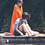 Suri Cruise and Katie Holmes dried themselves off after taking a dip in a pond in Kent, CT.