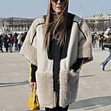 Anna Dello Russo layered up in a sporty-meets-luxe cropped-sleeve coat.