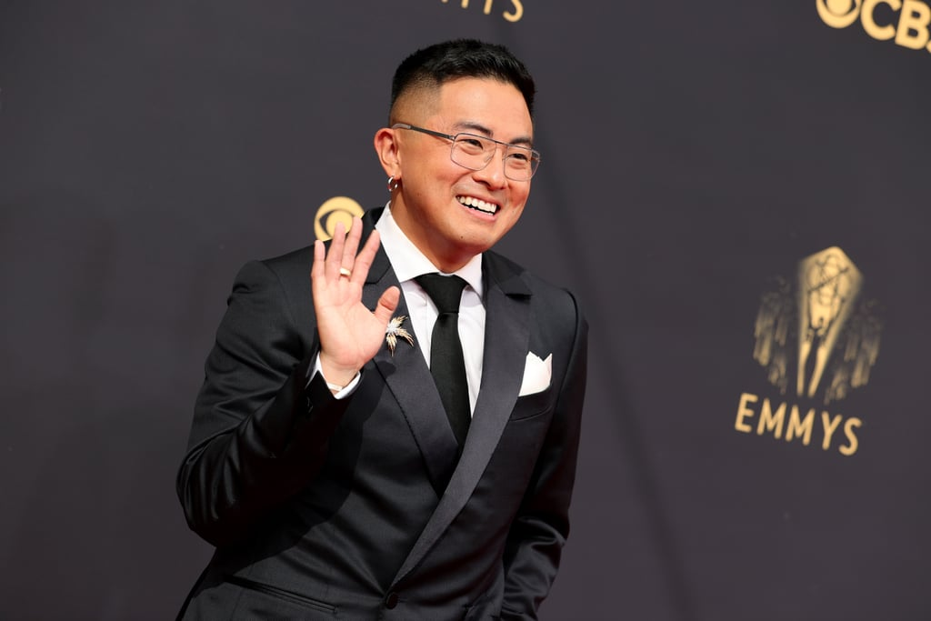 Bowen Yang made all other shoes irrelevant with his first-ever appearance at the Emmy Awards. The actor and Saturday Night Live cast member attended the award show on Sept. 19 wearing quite the intergalactic footwear: a pair of metallic silver platform heels by Brooklyn-based brand Syro.  A classic Ermenegildo Zegna suit served as the foundation for Bowen's outfit, which he also paired with a floral Tiffany & Co. brooch. Though he was certainly victorious on the red carpet, Bowen is also nominated for outstanding supporting actor in a comedy series, making him the first featured player to do so in the show's 46 seasons. Enjoy photos of his look ahead.      Related:                                                                                                           ICYMI, Binge-Watch the Emmys Red Carpet Right Here