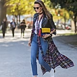 Wear a pair of distressed jeans with an ankle-length tartan duster. Finish your look off with a leather jacket and a statement bag.
