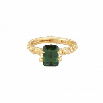 There's something so regal about this Polly Wales empress Rapunzel ring ($3,100), which boasts 18-karat yellow gold and a lush green tourmaline stone.
