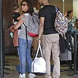 Alicia and Swizz both wore backpacks.