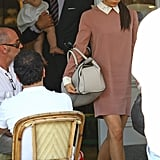 David Beckham carried Harper out of a restaurant in London after having lunch with Victoria Beckham.