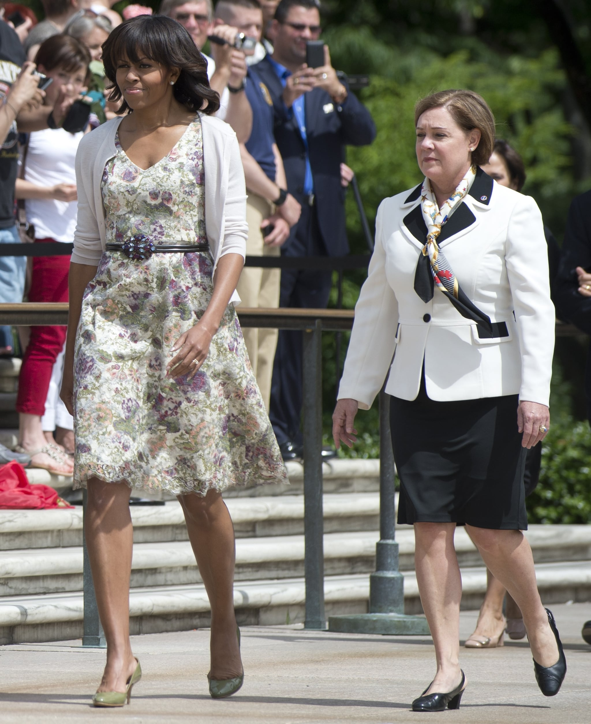For a Memorial Day appearance at Arlington National Cemetery, Michelle outfitted a floral-print dress with a cardigan and an embellished belt.