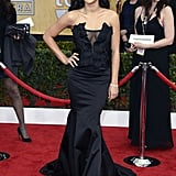 Naya Rivera struck a fierce pose in a black satin Donna Karan Atelier number with a sexy exposed corset detail.