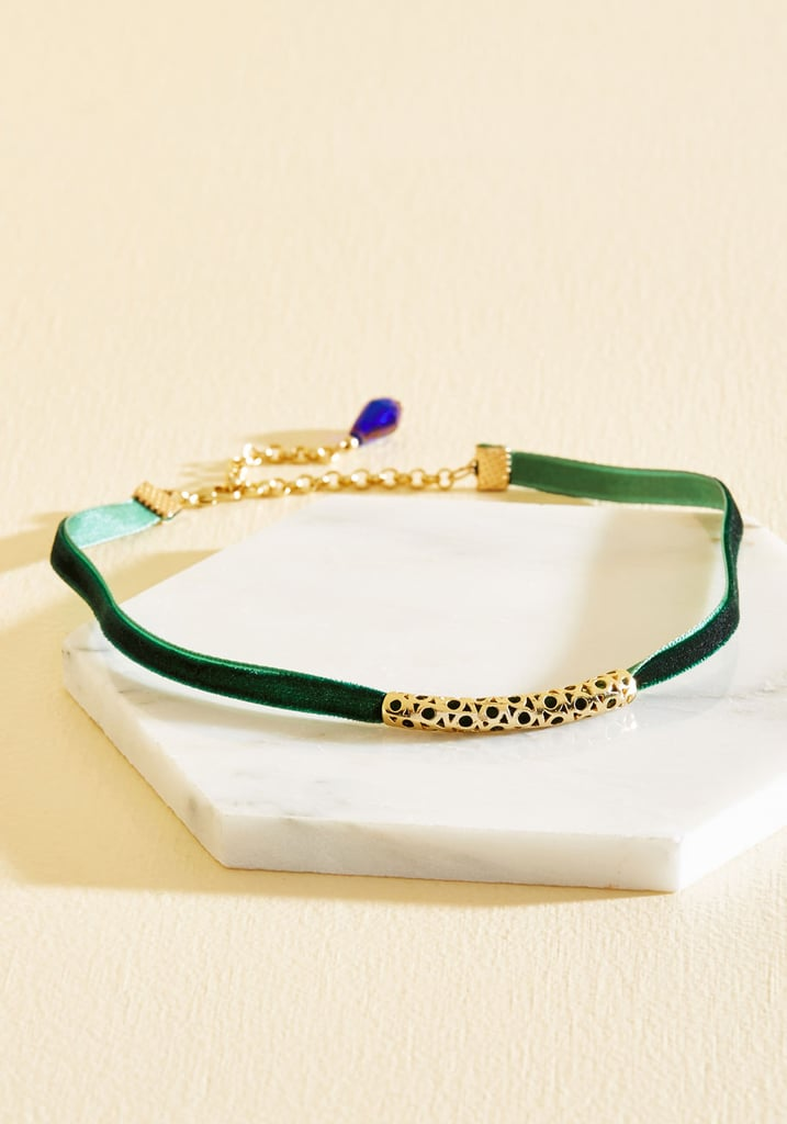 Velvet Choker ($23) Finally, finish off your look with a delicate, on-trend choker. The hunter-green hue ties back into the overalls, while the filigree accent adds a luxe touch.