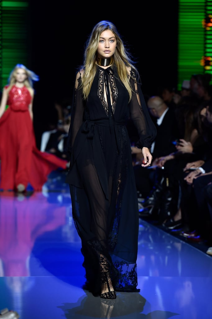 Gigi also wore a dark, romantic lace gown at Elie Saab. Her sheer chiffon number was complete with the same pair of heels and a thick edgy statement choker.