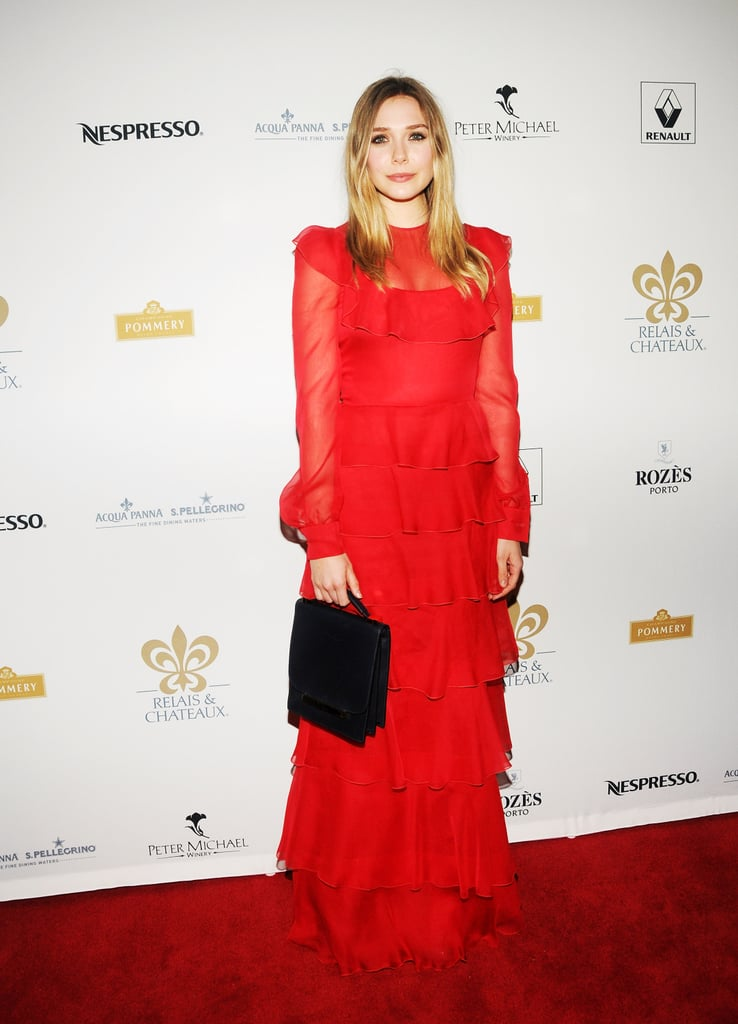 Elizabeth Olsen looked stunning in a bright red ruffled gown and carried her handbag from The Row to the Grand Chefs Tasting Dinner.