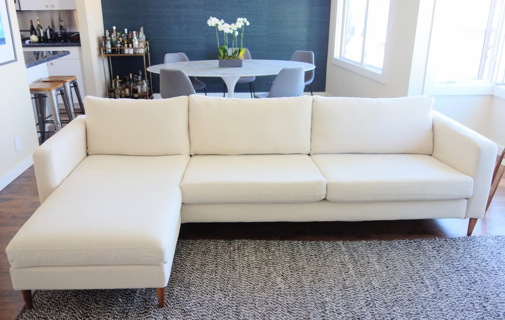 "Next, I substituted the basic Ikea cover for a custom cover from Bemz, a Swedish company that specializes in high-end Ikea slipcovers. I chose the Porridge Linara by Romo, and got the Karlstad three seater sofa cover ($439, originally $549) and chaise add on cover ($223, originally $279).  Choosing a slipcover for an Ikea piece comes with many practical benefits. For one, they're machine washable — so I could feel good about that light color. Bemz also produces their custom covers on demand, which helps cut down on waste, making them eco-friendly. In addition, the company uses quality, natural fabrics, like linens and cotton. ""We think our products are extremely affordable for something that is custom made,"" founder Lesley Pennington tells us. They have 300 fabrics to choose from."