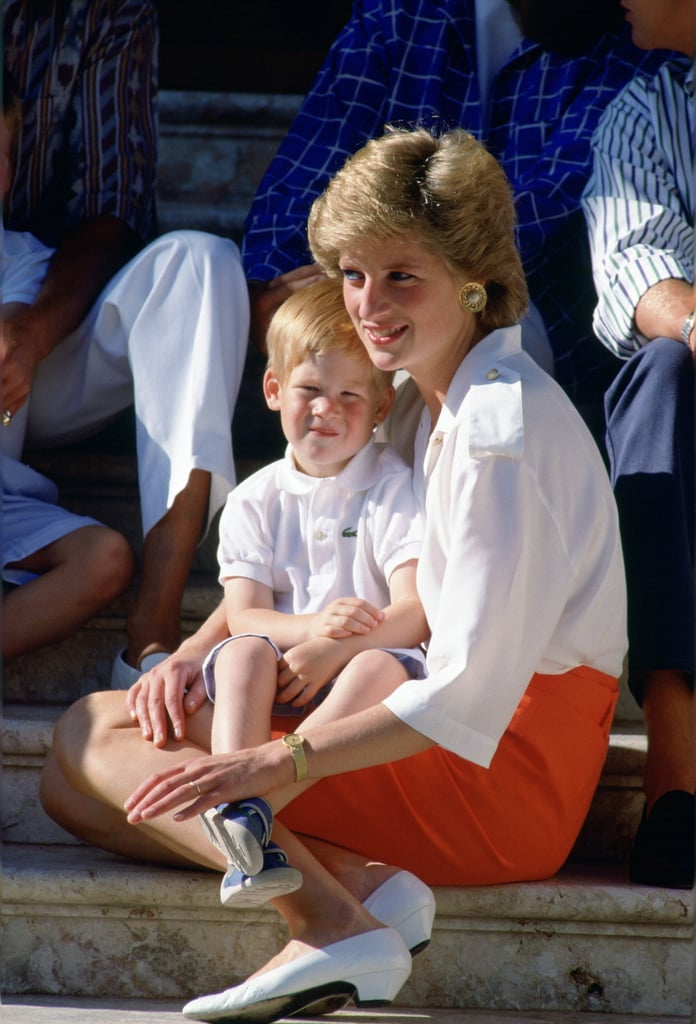 In August 1988, Harry sat on his mother's lap during a photocall in Spain.