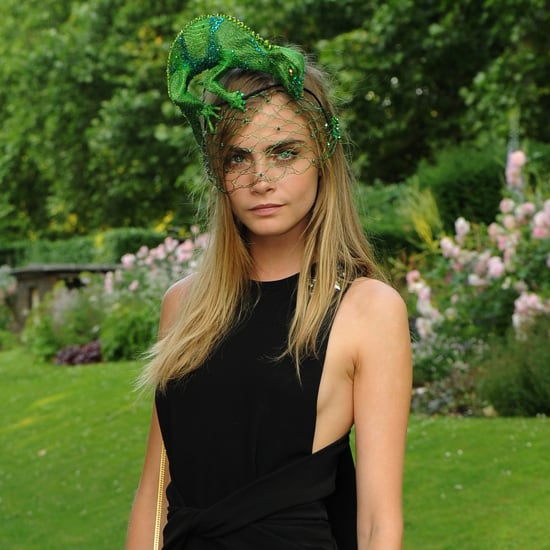 Cara Delevingne was one of the many guests spotted at the royal charity ball for the Elephant Family foundation yesterday. Extravagant animal masks were the theme of the event, with Prince Charles and the Duchess of Cornwall seen wearing a golden tiger and a glittery sliver elephant mask, respectively. But, it was Miss CD's headwear that caught our eye. Swapping from a black leather, gladiator inspired piece to a sparkly green lizard, this cheeky beauty was all laughs. Come see her hair from all angles!