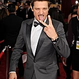 Jeremy Renner threw up a peace sign.