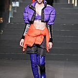 A Model Wearing a Cropped Puffer With Purple Thigh-High Boots