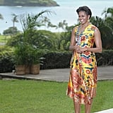 Michelle wearing a satin floral dress while making an appearance in Oahu, Hawaii.