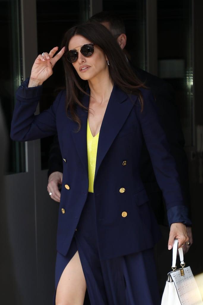 Wear your neon one-piece under sophisticated workwear for a bold twist like Penelope Cruz.