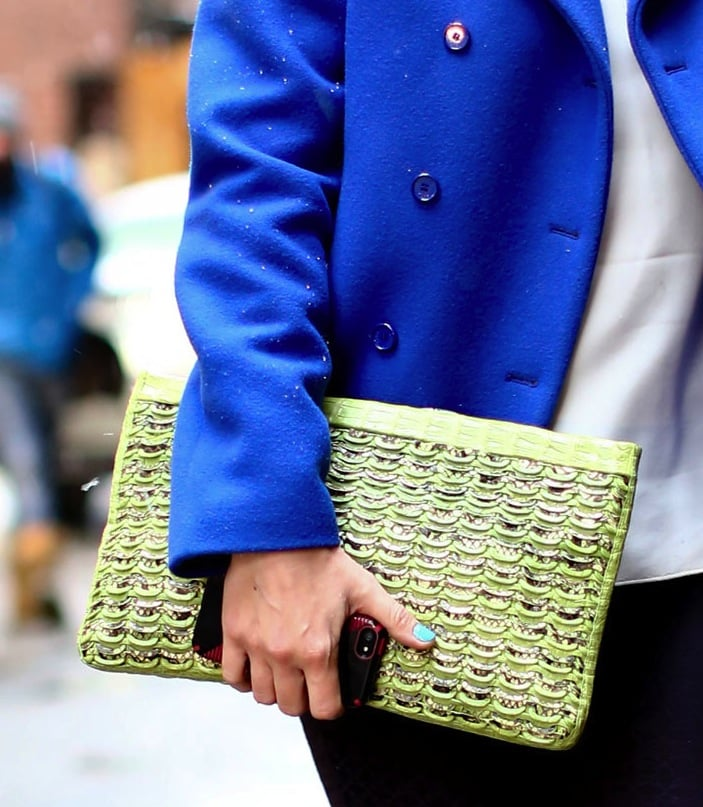 We're coveting the textural print on this oversize lime green clutch.