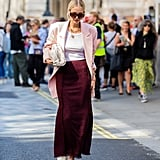 While your pale pink blazer might be the perfect pairing with your favorite blue jeans, we love it equally when styled with a burgundy ankle-length skirt.