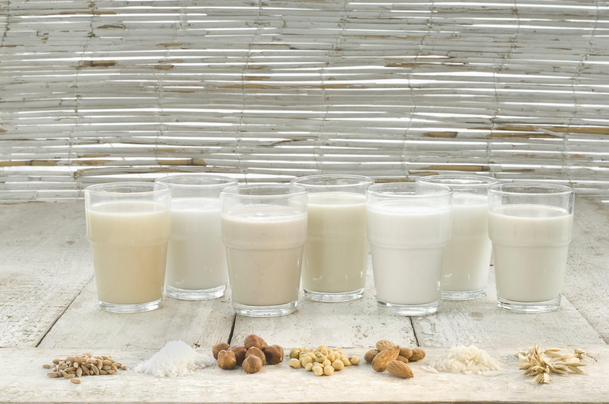 Various types of lactose-free milks in glasses