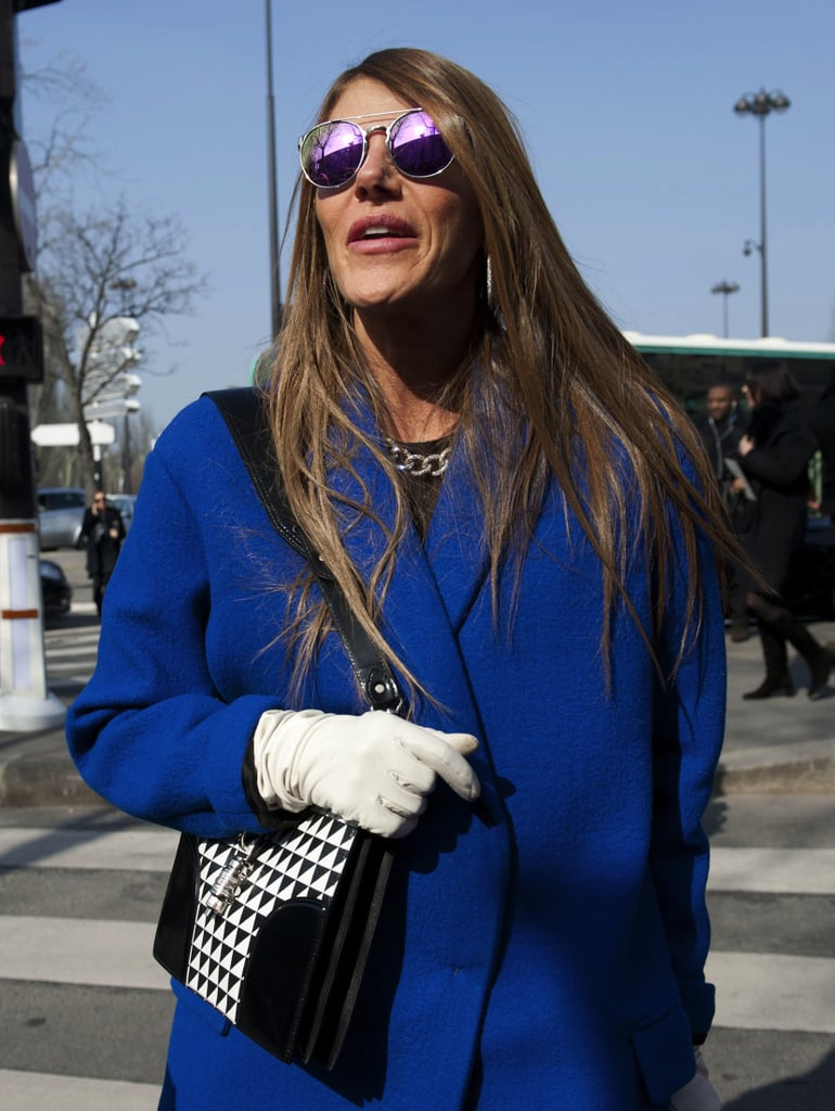 Anna Dello Russo showed off her styling cred in reflective shades and a graphic printed bag.