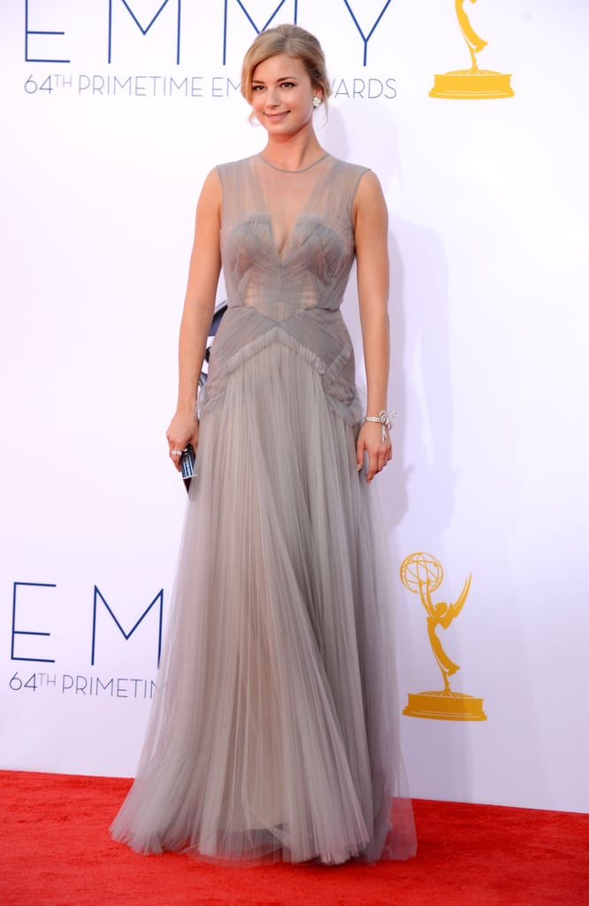 Revenge star Emily VanCamp chose a romantic gray J. Mendel gown for the Emmy Awards tonight. She paired a sparkly diamond bracelet and dark clutch to complement the neutral tone. Emily and boyfriend, and costar, Josh Bowman are often spotted sharing PDA on and off the set, but we'll have to wait and see if he's her plus-one inside the show. Stay tuned because we're keeping a close eye on all the celebrities as they arrive, so be sure to watch PopSugar's live Emmys show! Also, don't forget to vote on all of our Emmys polls here!