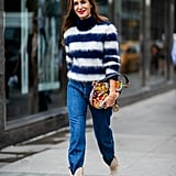 Go quirky-chic by teaming a striped sweater with jeans and tucking them into cowboy boots (like Princess Diana) with a printed bag to finish.