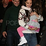 Katie Holmes carrying Suri in Pittsburgh with Tom Cruise.