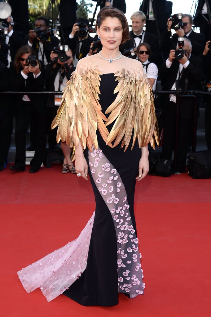 Forget a single color — Laetitia Casta preferred full glamour at the festival's closing ceremony. The model picked a long dress with a floral, sheer panel and topped it all off with golden wings.
