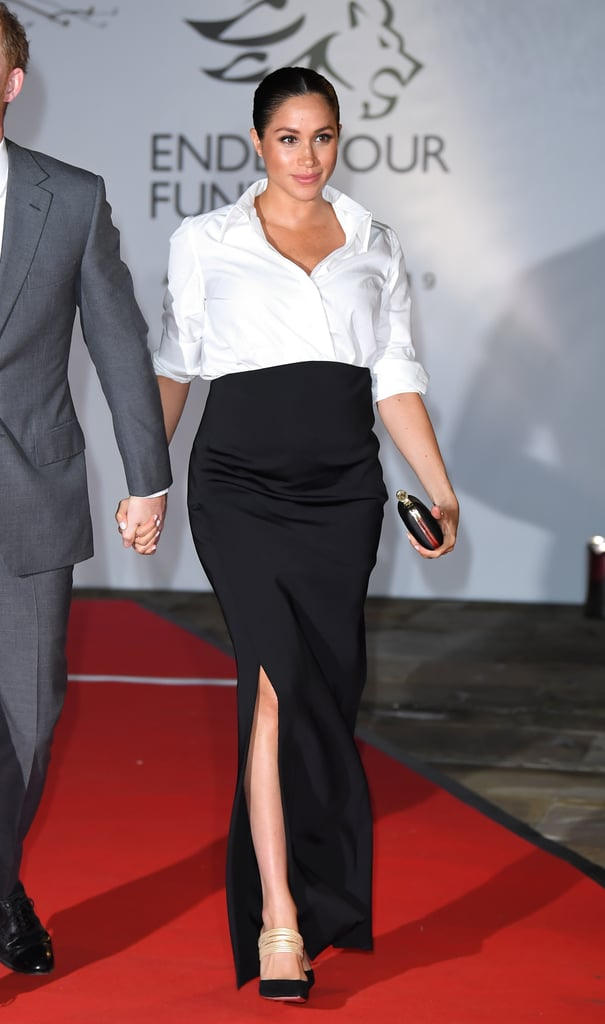 Meghan wore Rachel's familiar outfit formula to the Endeavour Fund Awards back in early 2019. The Duchess of Sussex, who was pregnant with Archie at the time, tucked a sleek white shirt into a high-waisted maxi skirt with a slit, both designed by Clare Waight Keller for Givenchy.