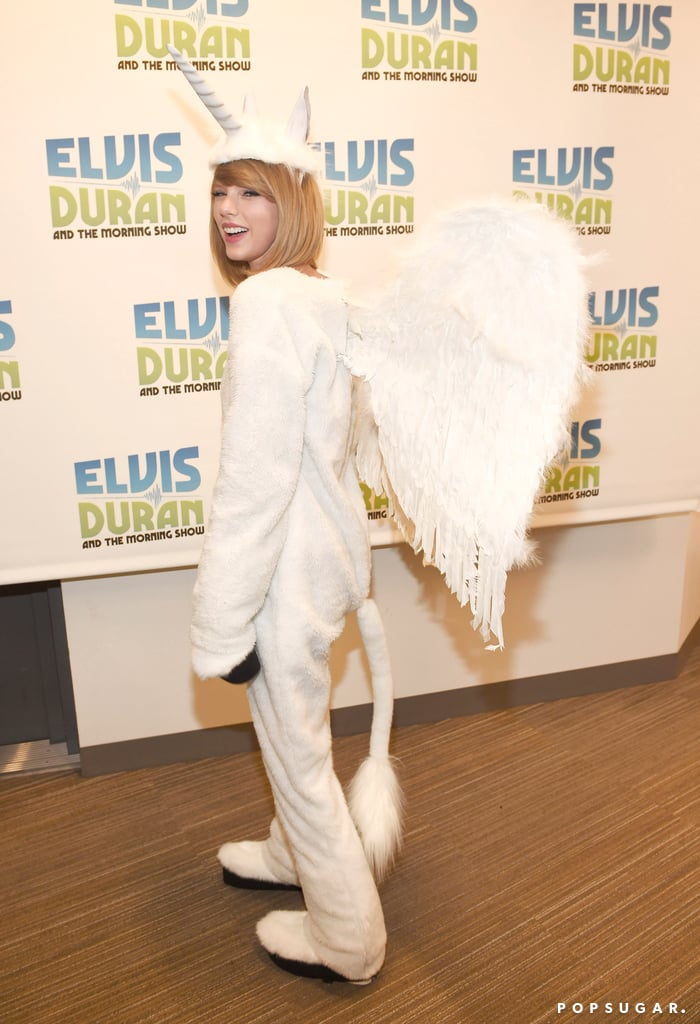"Taylor Swift played homage to her ""Ew!"" skit with Jimmy Fallon when she dressed up as a ""Pegacorn"" for Halloween in NYC on Friday. The singer donned a comfy white onesie complete with a unicorn horn and white wings while she did press for her new album, 1989, at the Elvis Duran Z100 Morning Show. Fans may remember the ""pegacorn"" as the drawing/invention that Taylor's character made during an ""Ew!"" skit on The Tonight Show Starring Jimmy Fallon back in August. Naturally, the singer, who is known for her modest style, decided to skip out on the ""sexy"" Halloween costumes that most young celebrities her age tend to wear on All Hallows' Eve. Keep reading to see more from Taylor's look, and be sure to check out all the celebrity Halloween costumes from this year!"