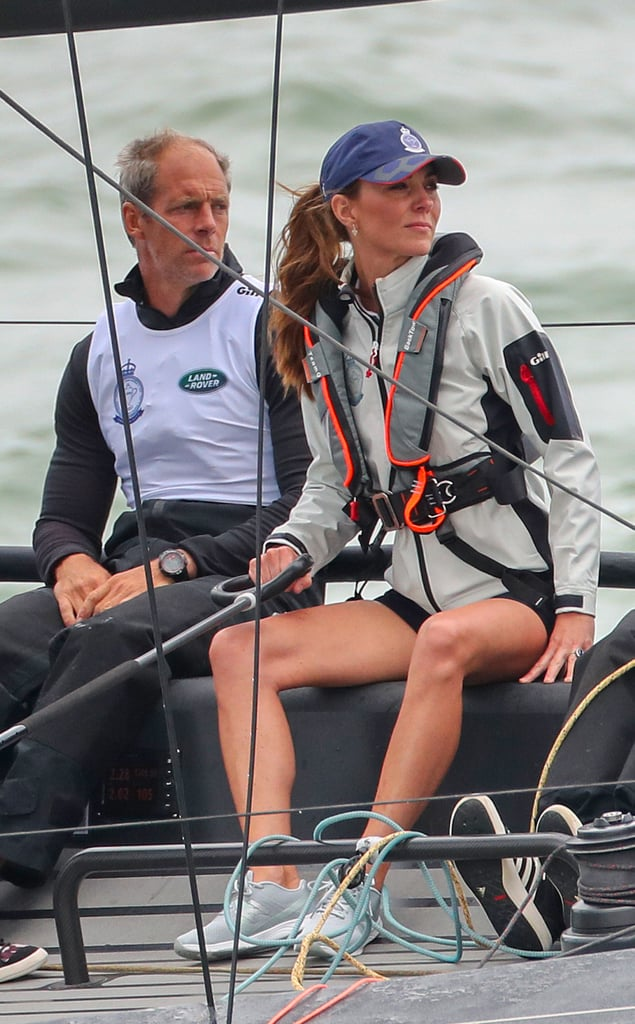 The Duke and Duchess of Cambridge travelled to Cowes on the Isle of Wight on Thursday to host a special boat regatta, The King's Cup, to raise funds and awareness for eight of the couple's royal patronages. William and Kate, who are both keen sailors, led two of the teams out on the water, while some very special spectators, Prince George and Princess Charlotte, watched from another boat with their grandfather Michael Middleton. Prince William's boat represented Child Bereavement UK, one of the patronages he took over from his mother, Princess Diana. The duchess competed on behalf of The Royal Foundation's Early Years programme. They were joined by a number of famous faces leading other charity teams, among them survival instructor and TV personality Bear Grylls, and comedian John Bishop.  The event was originally scheduled for Friday, but the great unpredictable British weather meant a decision was made to bring the event forward by a day for the safety of all involved. The Duke and Duchess and their teams seemed unfazed by this last-minute change, and as they arrived on site, they were raring to get with the competition. Once they were out at sea, we got a glimpse of both royals looking pretty focussed on beating the competition! Later in the day, William and Kate will be back on dry land to present the King's Cup to the winning team: the cup itself is a piece of royal history, having first been presented in 1920 by King George V at Cowes' Royal Yacht Squadron.