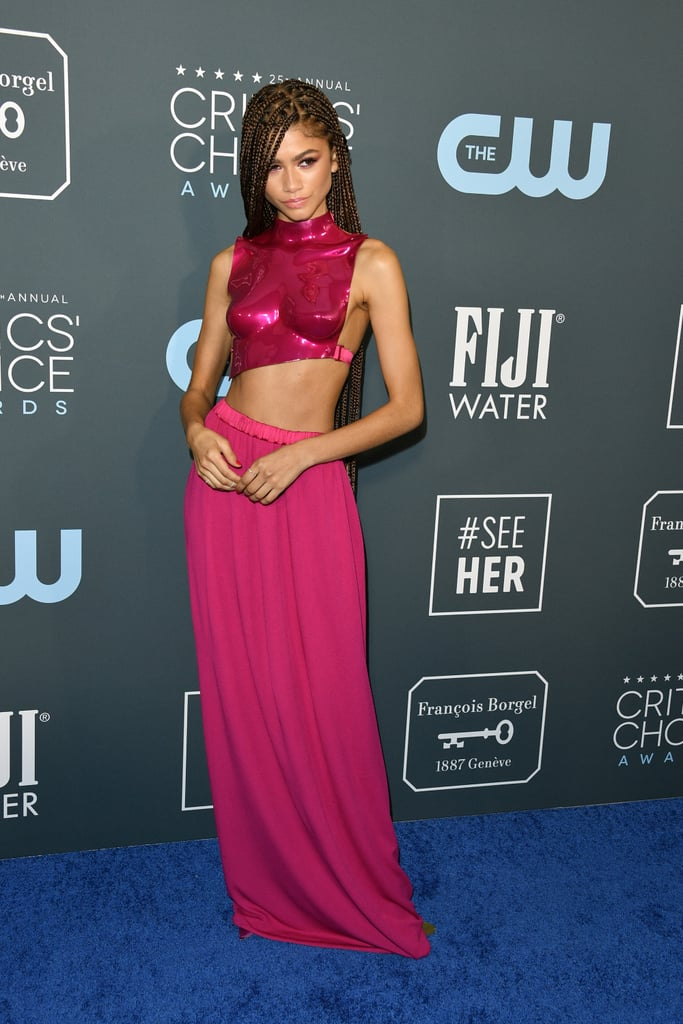 Zendaya, we are not worthy! The Euphoria-nominated actress walked the Critics' Choice Awards red carpet on Sunday night looking more like a Pink Power Ranger than Kimberly ever did. (My apologies to Kimberly.) She wore a sculpted chrome chest piece courtesy of Tom Ford with a matching jersey skirt and Louboutin satin pumps. Wonder Woman is about to trade in her suit for this statement top.  Zendaya went with minimal Mateo New York and Djula jewelry, and let the outfit — and her incredible braids — do all the talking. Her stylist Law Roach should be resting with his feet up tonight; that's a job well done. Keep reading for more glimpses of Zendaya's full outfit.      Related:                                                                                                           And the Votes Are In! These Are the Most Glamorous Looks From the 2020 Critics' Choice Awards