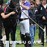 Prince Harry got onto his horse at a polo match in Cirencester, UK.
