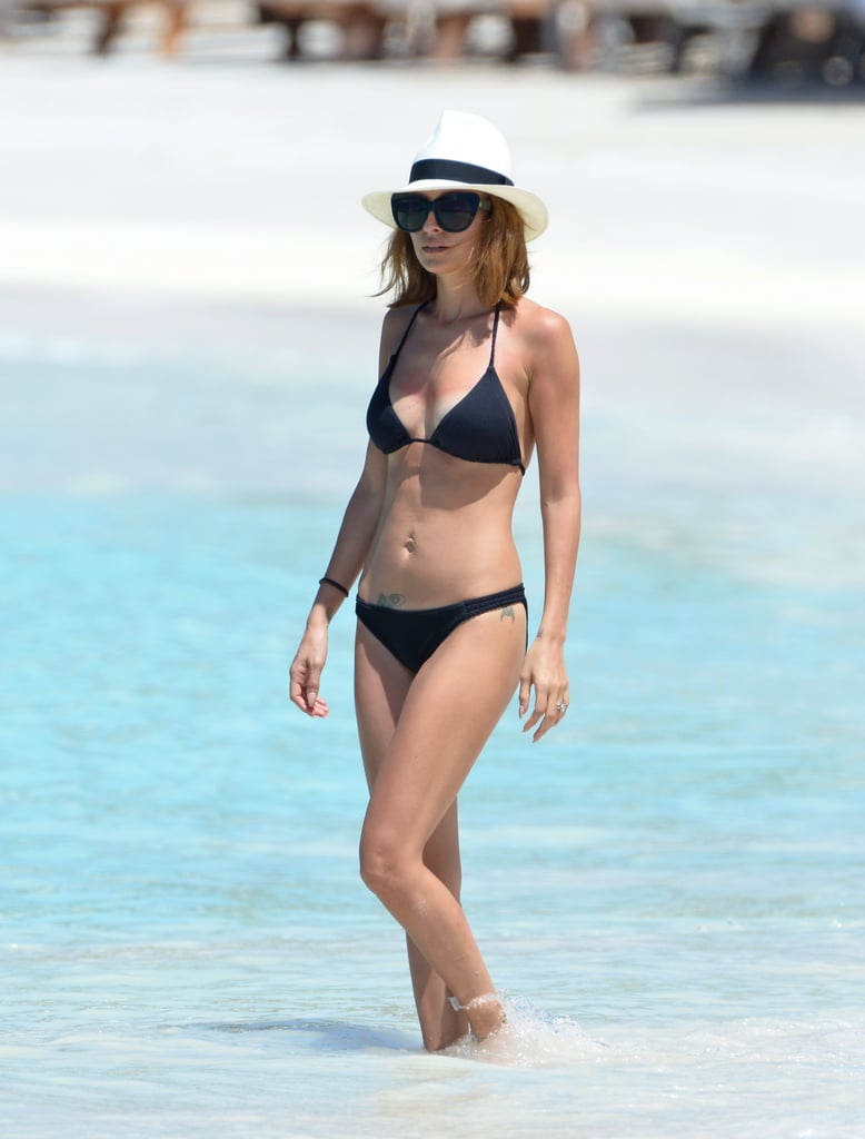 Nicole Richie slipped into a black bikini for a dip in the ocean at St. Barts on Friday. She wore the two-piece and House of Harlow sunglasses as she waded into the waters while chatting with two female friends. The trio laid out on a floating barge to soak up the sun before Nicole jumped off into the beautiful blue waters. Nicole and her friends are currently in St. Barts to celebrate the wedding anniversary for their friends Kelly Sawyer and movie producer Jamie Patricof. Jessica Alba is also among the group of pals who traveled to the tony vacation spot for the occasion, and she and Nicole were spotted sharing a chat and drinks earlier this week. Jessica has been getting in on the swimsuit action as well, donning a string bikini earlier this week for a cannonball contest with husband Cash Warren. Source: X17 Online, FameFlynet