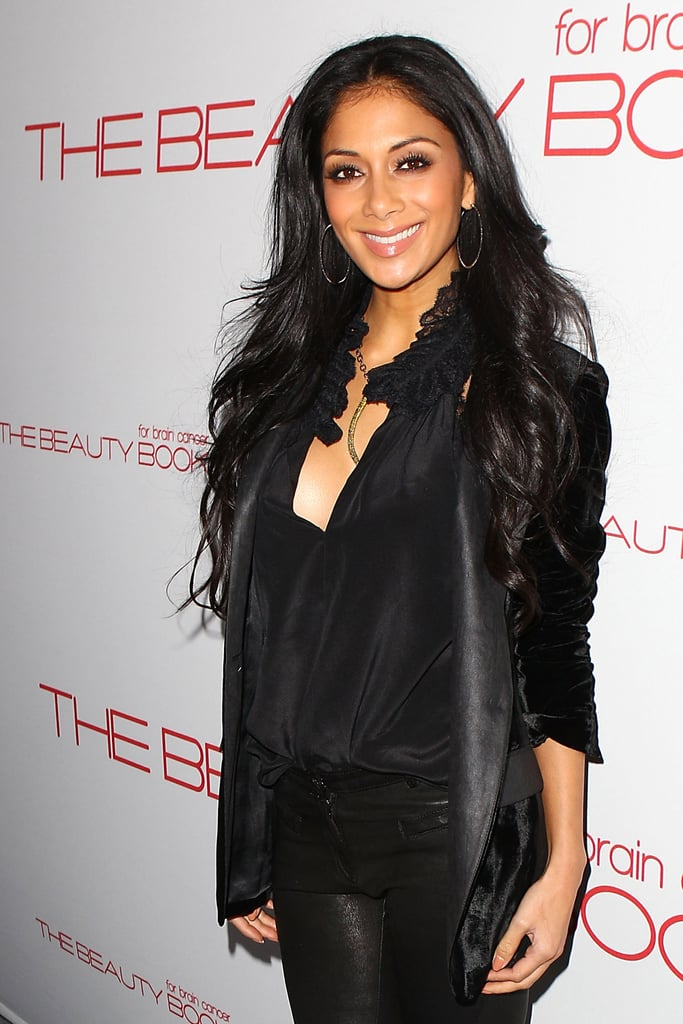 Nicole Scherzinger took a break from filming X Factor to support the book launch.
