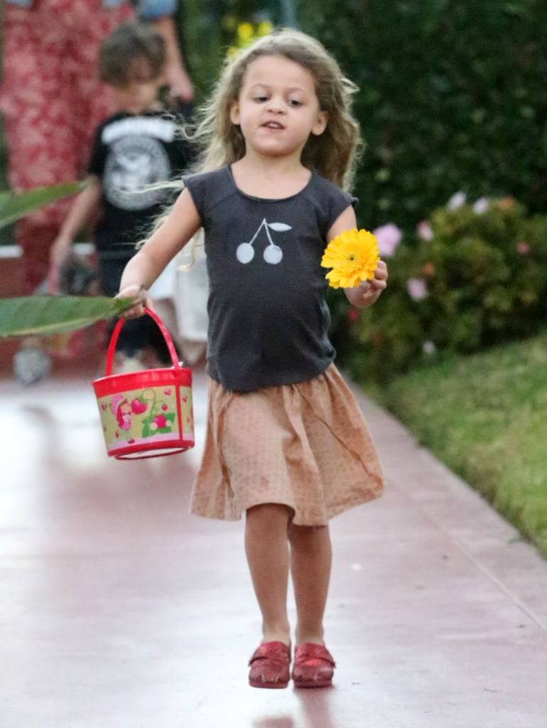 Harlow Madden carried a yellow flower.