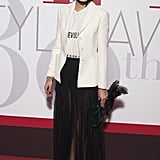 She Wore It With a Dior Blazer, Fringe Skirt, and Booties