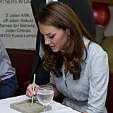 Kate Middleton signed her name at a dinner in Malaysia.