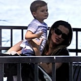 Gisele Bundchen held Ben at the park.