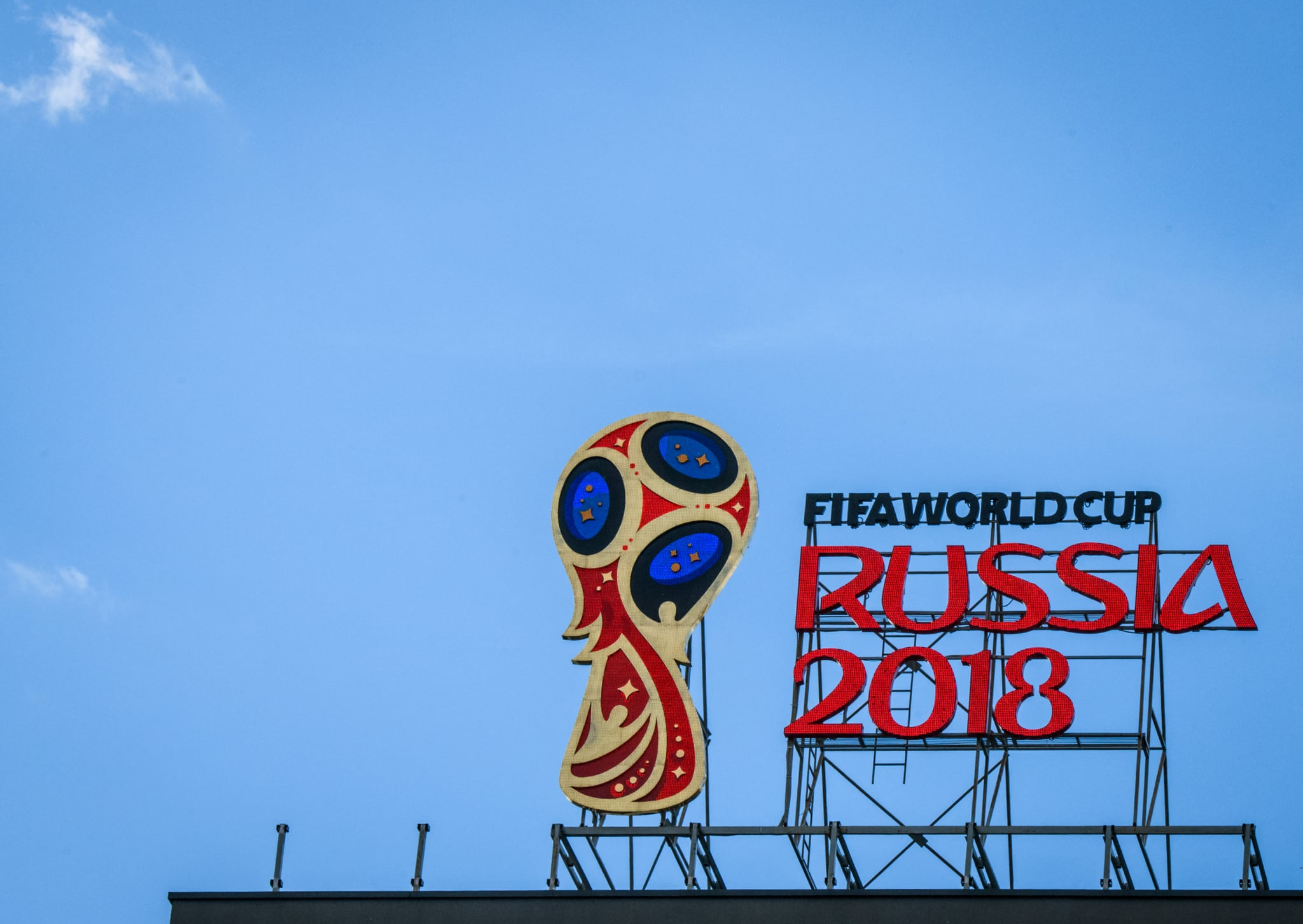 A picture taken on June 6, 2018 shows the 2018 FIFA World Cup logo on top of a building in Moscow. (Photo by Mladen ANTONOV / AFP)        (Photo credit should read MLADEN ANTONOV/AFP/Getty Images)