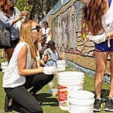 Nicole Richie was joined by helpful teens to fix up a mosaic mural during the event.