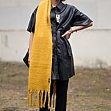 Throw a Bright Marigold Scarf Over an All-Black Outfit to Really Pop