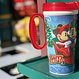 "Get a warm wintry refreshment in a ""Happy Holidays"" travel mug."