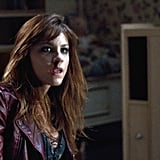 This gal looks rugged and thirsty; her burgundy leather jacket is perfectly vampy.