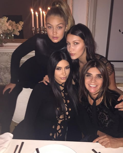 "Kim Instagrammed a photo from Carine Roitfeld's dinner party with the caption, ""Girls Girls Girls Girls @carineroitfeld @gigihadid @bellahadid."""
