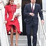 While arriving for their official tour of Australia and New Zealand in April 2014, a Catherine Walker-clad Kate was so focused on holding baby George that she had some trouble keeping her red coat dress from blowing in the wind. A little help here, William?