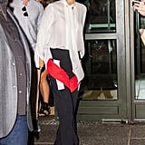 Fall staple: a long-sleeved pussy-bow blouse from Givenchy. Selena wore it with: contrast stripe Givenchy trousers and open-toed Saint Laurent sandals in New York City in August 2015.
