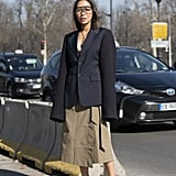 Have some fun with your work-friendly blazer blazer and skirt by styling them with '70s clear sunglasses.