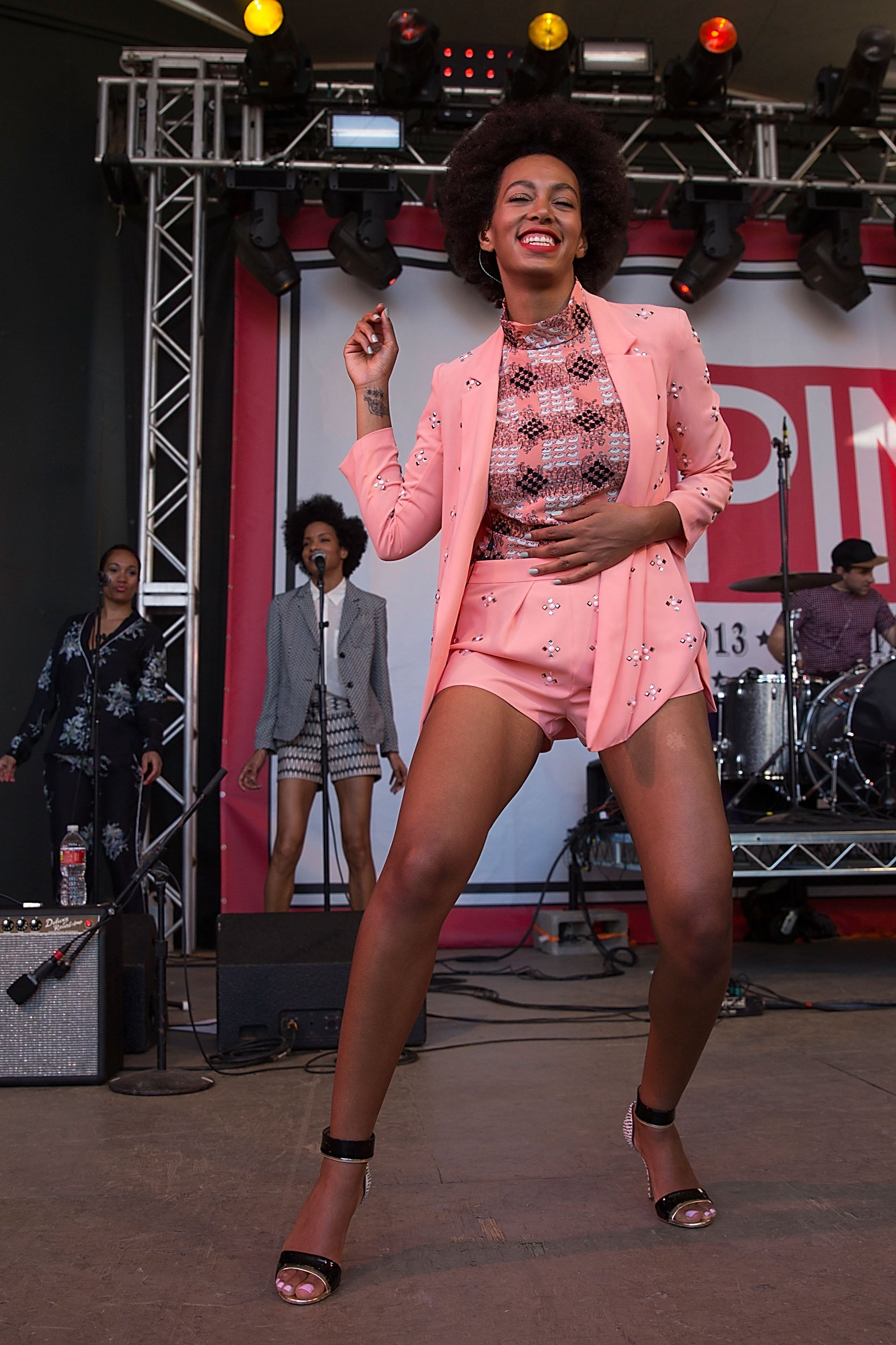 Solange was Spring-perfect in a pastel-hued suit and ankle-strap heels on stage at SPIN.